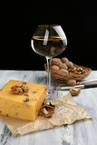 Tasty Italian cheese and glass of vine on wooden table