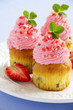 Muffins with whipped cream and strawberries.