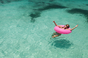 Young women relax in floating
