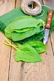 Spinach on board with knife and napkin