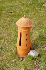 New terracotta lamp on the grass