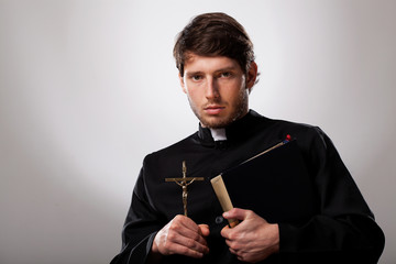Priest with cross and holy bible