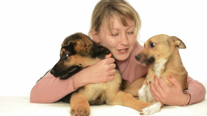 young woman with two puppies