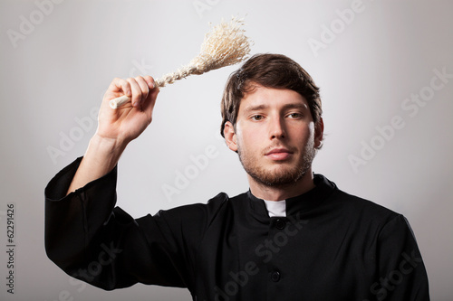 Priest with sprinkler