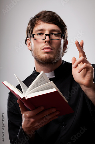 Priest with Holy Bible