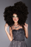 Extravagance. Eccentric Woman in Frizzy Wig with Braided Hairs