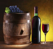 Still life with wine barrel, bottle and glass.