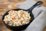 Cast-iron pan with pilaf, horizontal shot