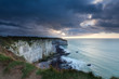 stormy clouded sky over cliffs in ocean