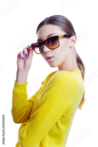 Stylish beautiful woman in sunglasses and yellow sweater