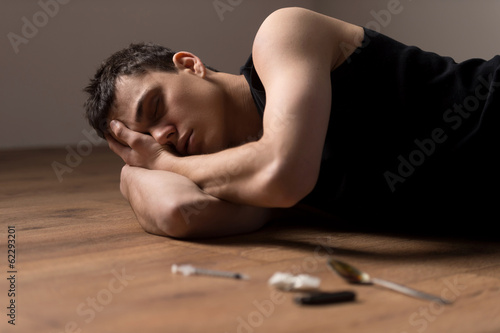 young handsome man lying on floor.