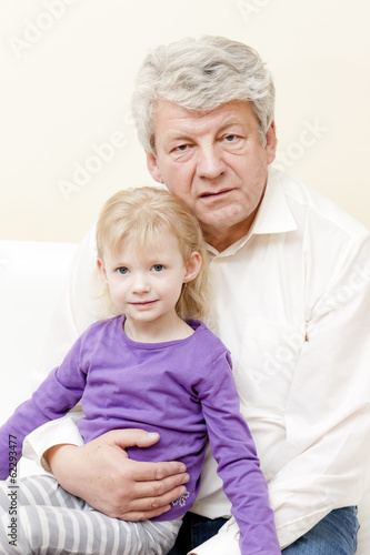 portrait of grandfather with his granddaughter