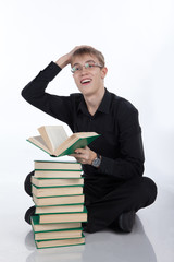 Teen with a pile of books on white background