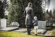 mother and child at graveyard - 62294004