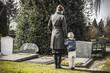 Leinwanddruck Bild - mother and child at graveyard