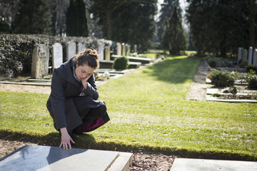 widow at grave of deceased husband