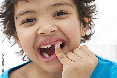 Child boy hand pointing his baby milk teeth fall out