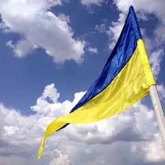Ukrainian flag on the blue sky
