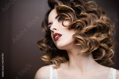 Beauty styled closeup portrait of a young woman - 62295402