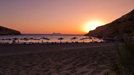 Sunset at Matala beach, island of Crete