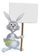 White bunny rabbit with carrot sign