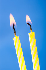 Two burning birthday candles