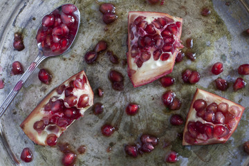 pomegranate and grains on ancient silver tray with spoon