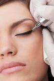 Fototapety professional tattooist making permanent make-up.