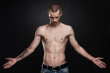 attractive young man standing with tattoo.