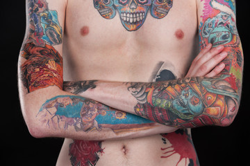colorful tattoo chest of young man.