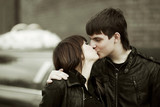 Happy young couple kissing outdoor