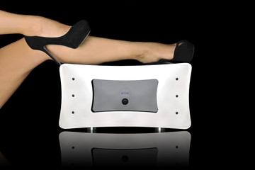 A sound amplifier close up shoot with woman legs