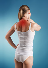 Woman suffer from neck pain, over blue background