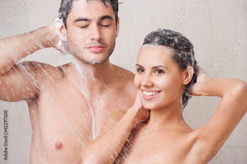 beautiful couple washing in the shower