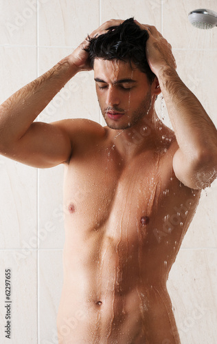 Sexy man washing in bathroom