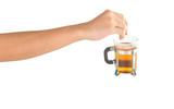 Female hand dipping a teabag in hot water