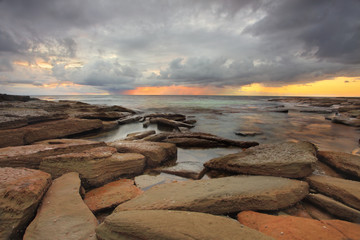 Sun rays, rocks and storm clouds
