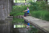 man on the outdoor suspension training at the water