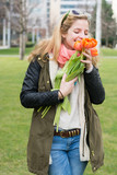 young woman holding tulips