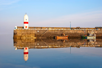 Old Lighouse and two Boats with water Reflection