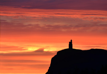 Sunset sky with Milner Tower on Brada Head, Isle of Man, UK