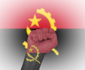 Fist wrapped in the flag of Angola