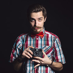 Portrait of a cheerful photographer in studio
