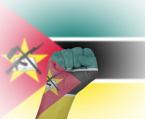 Fist wrapped in the flag of Mozambique