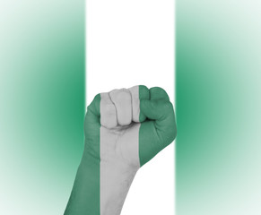 Fist wrapped in the flag of Nigeria