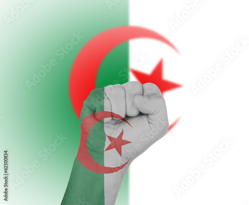 Fist wrapped in the flag of Algeria
