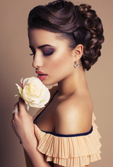 beautiful woman with dark hair with rose