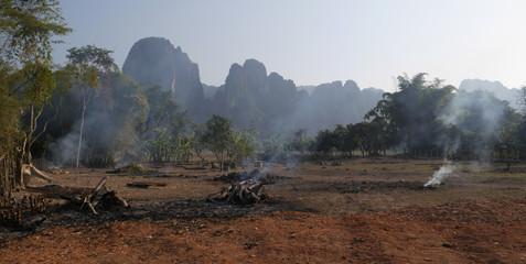 Smoke, red sand, mountains, Vang Vieng, Laos