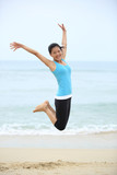 Happy woman jumping on the beach. summer holidays