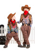 Two boys posing in cowboy costumes